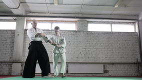 Athletes in a kimono demonstrating martial arts techniques. martial arts. Two athletes in a kimono demonstrating martial arts techniques. martial arts stock footage