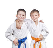 Athletes in a kimono and with different belts. Boys in a kimono and with different belts stock photos