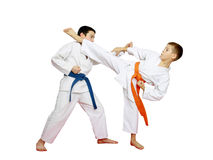 Athletes in kimono are training karate technique Stock Photos