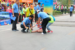 The athletes of the leg cramps. Half international marathon in fushui county in yunnan province in China, time: on September 25, 2013 Stock Photo