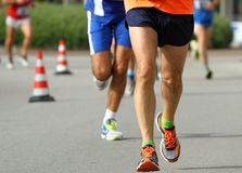 Athletes ' legs with sneakers run fast. To the finish line Stock Photo