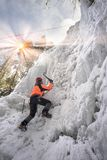Athletes at Manyavsky Falls in Winter royalty free stock image