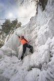 Athletes at Manyavsky Falls in Winter royalty free stock photography