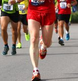 Athletes during the marathon Stock Photos