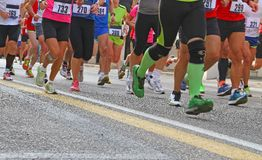 Athletes during the marathon Stock Images