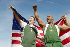 Athletes With Medal And American Flag Stock Image