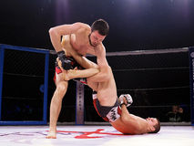 Athletes in the Octagonal ring for fights extreme Sport mixed martial arts competition tournament MMA  MAXMIX. Odessa, Ukraine - 24 November 2015: Athletes in Stock Images