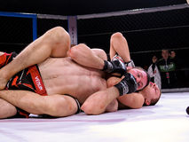 Athletes in the Octagonal ring for fights extreme Sport mixed martial arts competition tournament MMA  MAXMIX Stock Photos