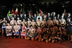 Athletes and Officials Pose for a Group Photo. BANGKOK - MARCH 23: Athletes and officials pose during the closing ceremony of the World Amateur Muay Thai Stock Photos