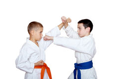 Athletes with orange and blue belt doing reception Stock Photography