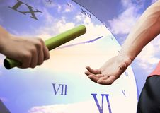Athletes passing the baton against digitally generated clock in background. Composite image of athletes passing the baton against digitally generated clock in stock image