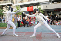 Athletes perform fencing Stock Images