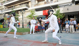 Athletes perform fencing Royalty Free Stock Photos