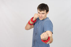 Athletes perform punches with the weighting Stock Photography