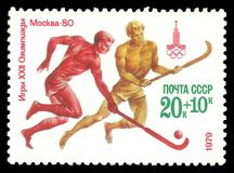 Athletes playing field hockey. USSR - CIRCA 1979: Stamp printed by USSR, Multicolor edition offset printing on topic of Moscow Summer Olympic Games 1980, shows Royalty Free Stock Photo