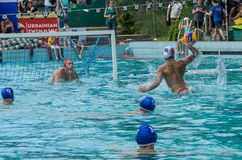 LVIV, UKRAINE - JUNE, 2019: Athletes in the pool playing water polo. Athletes in the pool playing water polo stock image