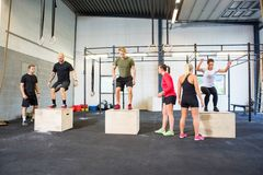 Athletes Practicing Box Jumps Royalty Free Stock Image