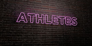 ATHLETES -Realistic Neon Sign on Brick Wall background - 3D rendered royalty free stock image Royalty Free Stock Image