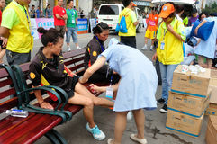 The athletes are receiving treatment. Half international marathon in fushui county in yunnan province in China, time: on September 25, 2013 Stock Photo