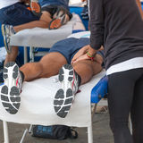 Athletes relaxation massage before sport event Stock Photography