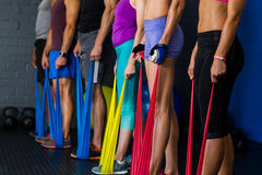 Athletes with resistance band in gym Stock Photography