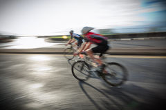 Athletes riding bicycles Stock Photos
