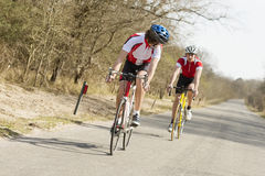 Athletes Riding Cycles Royalty Free Stock Image