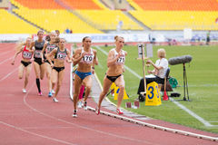 Athletes run in circles on International athletic competition Royalty Free Stock Photography