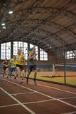 Athletes run a distance of 5 km in the arena Royalty Free Stock Photo