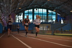 Athletes run a distance of 5 km in the arena Royalty Free Stock Photography