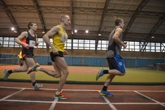 Athletes run a distance of 5 km in the arena Stock Photos