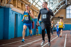 Athletes run a distance of km in the arena race at one mile and athletics dnepropetrovsk institute physical education january royalty free stock image