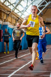 Athletes run a distance of km in the arena race at one mile and athletics dnepropetrovsk institute physical education january stock photo
