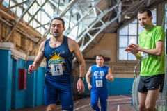 Athletes run a distance of km in the arena race at one mile and athletics dnepropetrovsk institute physical education january royalty free stock images