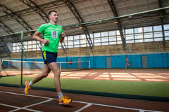 Athletes run a distance of km in the arena race at one mile and athletics dnepropetrovsk institute physical education january Royalty Free Stock Photos