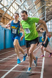 Athletes run a distance of km in the arena race at one mile and athletics dnepropetrovsk institute physical education january Stock Photography