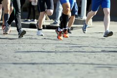Athletes run marathons on the pavement. The athletes run marathons on the pavement Royalty Free Stock Images
