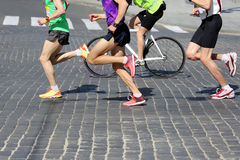 Athletes run marathons on the pavement. The athletes run marathons on the pavement Stock Photos