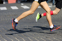 Athletes run marathons on the pavement. The athletes run marathons on the pavement Stock Photo