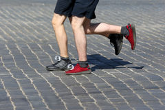 Athletes run marathons on the pavement. The athletes run marathons on the pavement Stock Image