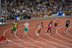 Athletes run race in Mens 220m sprint. Olympic Athletes race in Men�s 220m sprint inside the Birds Nest Stadium, Beijing China Royalty Free Stock Photos