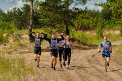 Athletes run between stages in extrim race.Tyumen Royalty Free Stock Images