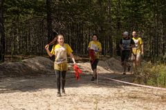 Athletes run between stages in extrim race.Tyumen Royalty Free Stock Photos