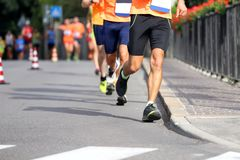 Athletes run in the street in the city. Many athletes run in the street in the city during the sports competition Royalty Free Stock Photo