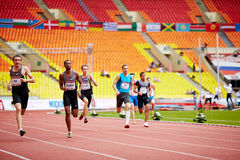 Athletes run on track of Grand Sports Arena Royalty Free Stock Photos