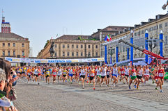 Athletes running Stock Images