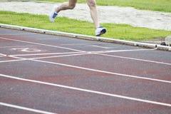 Athletes running, sports. Athletes running on the athletics track Royalty Free Stock Images