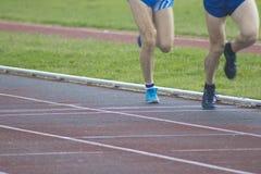 Athletes running, sports. Athletes running on the athletics track Stock Images