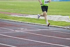 Athletes running, sports. Athletes running on the athletics track Royalty Free Stock Image
