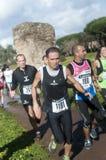 Athletes running Marathon of the Epiphany, Rome, Italy. Runners competing in Marathon of the Epiphany in Parco Degliacquedotti, Rome, Italy Stock Photo